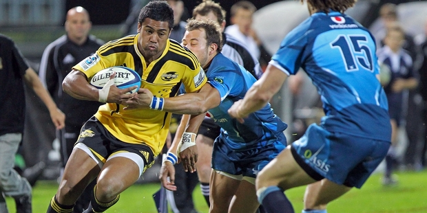 BULLISH: Julian Savea, Hurricanes wing, makes headway against the Bulls at McLean Park in 2011.PHOTO/FILE