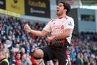 Liverpool's Luis Suarez celebrates his hat-trick against Cardiff. He has 28 league goals this season. Photo / AP