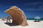 Wave 1 by artist Annette Thas is made from hundreds of Barbie dolls. Photo / Getty Images