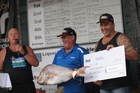 Kaitaia man Neil Sides is delighted at winning the $30,000 top prize, with organiser Dave Collard (left) and Northland MP Mike Sabin. Photo/Peter de Graaf
