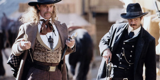Keith Carradine as Wild Bill Hickock and Timothy Olyphant as Seth Bullock.