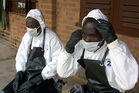 Members of the health department of the Gabonese army wearing their special equipment at Mekambo hospital. Photo / AFP