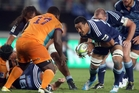 Jerome Kaino lines up Trevor Nyakane of the Cheetahs on Saturday night. The loosie appears to have lost none of his power after  two years in Japan. Photo / Getty Images