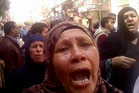 Relatives reacting after an Egyptian court sentenced to death 529 people. Image / AP