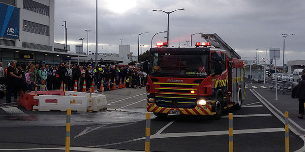A crowd gathered outside Auckland Airport after it was evacuated this morning. Photo / Brendan Manning