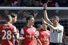 Kieran Gibbs was sent off against Chelsea after Alex Oxlade-Chamberlain handled the ball in the box. Photo / AP