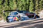 Sebastien Loeb attacks Pikes Peak in the Peugeot 208 T16 last year.