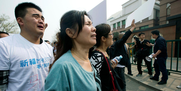 Relatives of passengers onboard Malaysia Airlines Flight 370 protest outside the Malaysian Embassy in Beijing, China. Photo / AP