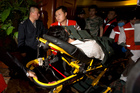 A relative of one of the Chinese passengers aboard the Malaysia Airlines MH370 is taken away on a stretcher. Photo / AP