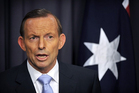 Tony Abbott insists his decision to bring back knights and dames won't harness Australia to the monarchy. Photo / AFP