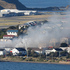 Smoke billowing from the Kiwi Storage facility as firefighters struggle to control the blaze near Wellington Airport. Photo / Mark Mitchell