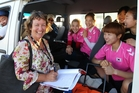 Local volunteer and Korean team liaison manager Annette Black with the Korean hockey team, here for the Hawke's Bay Festival of Hockey, at Unison Hockey Stadium, Regional Sports Park, Hastings. Photo/Paul Taylor