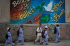 Artwork encouraging people to vote has appeared on walls around Kandahar and other cities in the leadup to the presidential election. Photo / AP