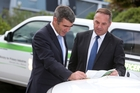 Primary Industries Minister Nathan Guy and his ministry's deputy director general compliance and response Andrew Coleman. Photo / Michael Cunningham