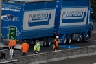 The line of blue paint that the truck left in its wake on Auckland's Northwestern Motorway turned to a puddle once the vehicle stopped. Picture / Brett Phibbs