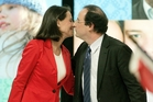 Segolene Royal kisses President Francois Hollande, her former partner. She was this week given a key Cabinet position. Photo / AP