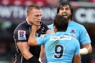 Jean Deysel of the Sharks and Nick Phipps of the Waratahs in one of many incidents. Photo / Getty Images