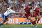Mike Harris breaks away for the Reds. Photo / Getty Images