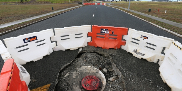 WHO PAYS? A failed stormwater system on the new Marsden City development has resulted in manholes collapsing and the road being closed. PHOTO/MICHAEL CUNNINGHAM