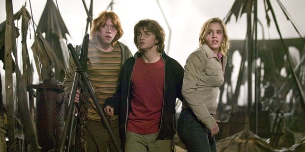 Harry Potter author JK Rowling will pen a spin-off trilogy to the wizard tale.