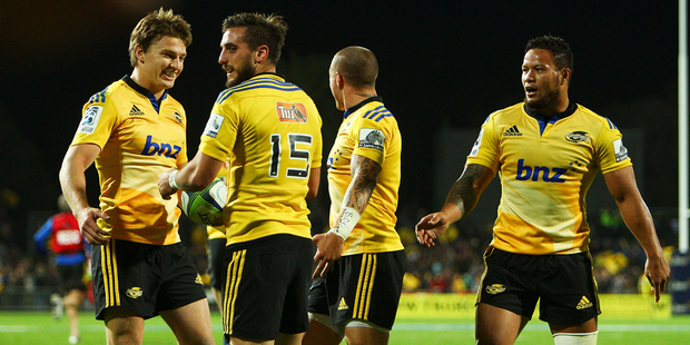 Andre Taylor of the Hurricanes is congratulated by teammates Beauden Barrett (L), TJ Perenara and Alapati Leiua (R) during the match between the Hurricanes and the Bulls. Photo / Getty Images.