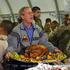 George W. Bush carries a platter of turkey and fixings as he visits U.S. troops in  Baghdad. Photo / Anja Niedringhaus