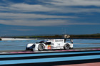 The team of Timo Bernhard, Mark Webber and Brendon Hartley test the Porsche 919 Hybrid.