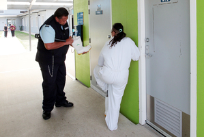A prisoner is searched at the women's facility. Photo / Doug Sherring