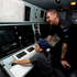Jaednan Roebeck, 5, from Devonport in the ops room with Daniel Powell on board the navy ship the HMNZS Te Mana. Photo / Dean Purcell