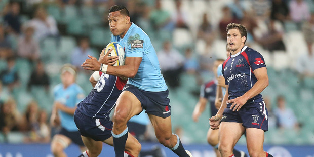 Israel Folau could barely speak after copping a stray elbow in the Waratahs' win over the Melbourne Rebels. Photo / Getty Images