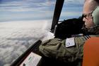 Flight Lieutenant Jayson Nichols looks out of the cockpit of a Royal Australian Air Force AP-3C Orion. Photo / AP