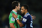 Highlanders fullback Ben Smith exchanges pleasantries with Blues replacement Benji Marshall after Saturday's match. Photo / Getty Images