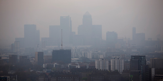 The skyscrapers of the Canary Wharf business district in London are shrouded in smog. Photo / AP
