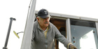 Uruguay's President Jose Mujica stands in a tractor on his flower farm on the outskirts of Montevideo, Uruguay. Photo / AP