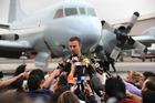Royal Australian Air Force pilot Flight Lt. Russell Adams speaks to the media. Photo / AP