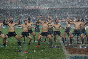 "All Black Sevens skipper DJ Forbes (left) leads the haka as the New Zealanders celebrate winning the ""Rugby World Cup of the world series"". Photo / AP"