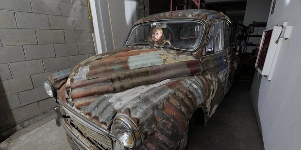 Penelope Jackson Gallery Director and the corrugated iron-clad Morris Minor that was part of  Corrugations .