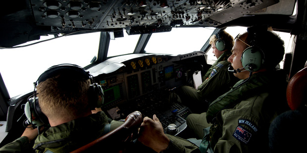 Royal New Zealand Air Force (RNZAF) aircrew on the flight deck of the P-3K2 Orion conducts a visual search.