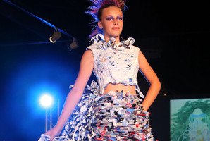 Lily Alkut models a wearable art outfit by NorthTec student Delwyn Milich. Plastic bags were ironed together to create dimensions in colour then melted to form the top. The tentacle-like bustle is constructed of strips of plastic sewn and melted into tight curls. PHOTOS/JOHN STONE