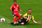 Ben Sigmund of the Phoenix tackles Michael Zullo of Adelaide United during the round 25 A-League match between Wellington Phoenix and Adelaide United. Photo / Getty Images.