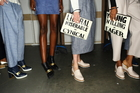 Karen Walker's oversized clutches ($220) reference the trend for slogans and typography. Picture / Supplied