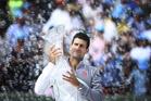 A bubbles surrounded Novak Djokovic celebrates winning the Sony Open. Photo / AP