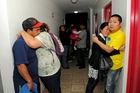 Frightened residents of an apartment block gather on an upper floor due to fears of a tsunami following the 8.2 magnitude earthquake in Chile. Photo / AP
