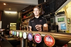AZZA'S POUR: Napier Pirate Rugby and Sports flanker Aaron McPhee on the job as a barman at Bar 1012 in Hastings.PHOTO/PAUL TAYLOR HBT141347-01