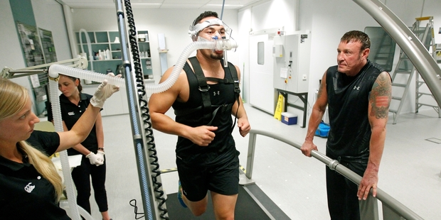 Boxer Joseph Parker during his fitness test, which he completed with a respectable score, watched by Kevin Barry (right). Photo / Chris Gorman