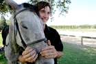 Josh Flannagan, 20, has found his place tending and looking after horses at the Trinity Valley riding school after years of bullying at school. Photo/Ruth Keber