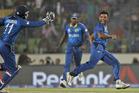 Sri Lanka's Seekkuge Prasanna, right, celebrates the wicket of West Indies' Lendl Simmons. Photo / AP