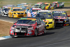 Fabian Coulthard drives the No 14 Lockwood Racing Holden at the head of the field yesterday. Photo / Getty Images