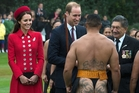 William, with Catherine, chats with Warrant Officer George Mana during the welcoming ceremony. At right is cultural adviser Lewis Moeau. Photo / AFP