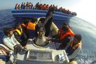 Immigrants stand on a boat during a rescue operation off the coast of Sicily on October 30, 2013. Photo / AFP